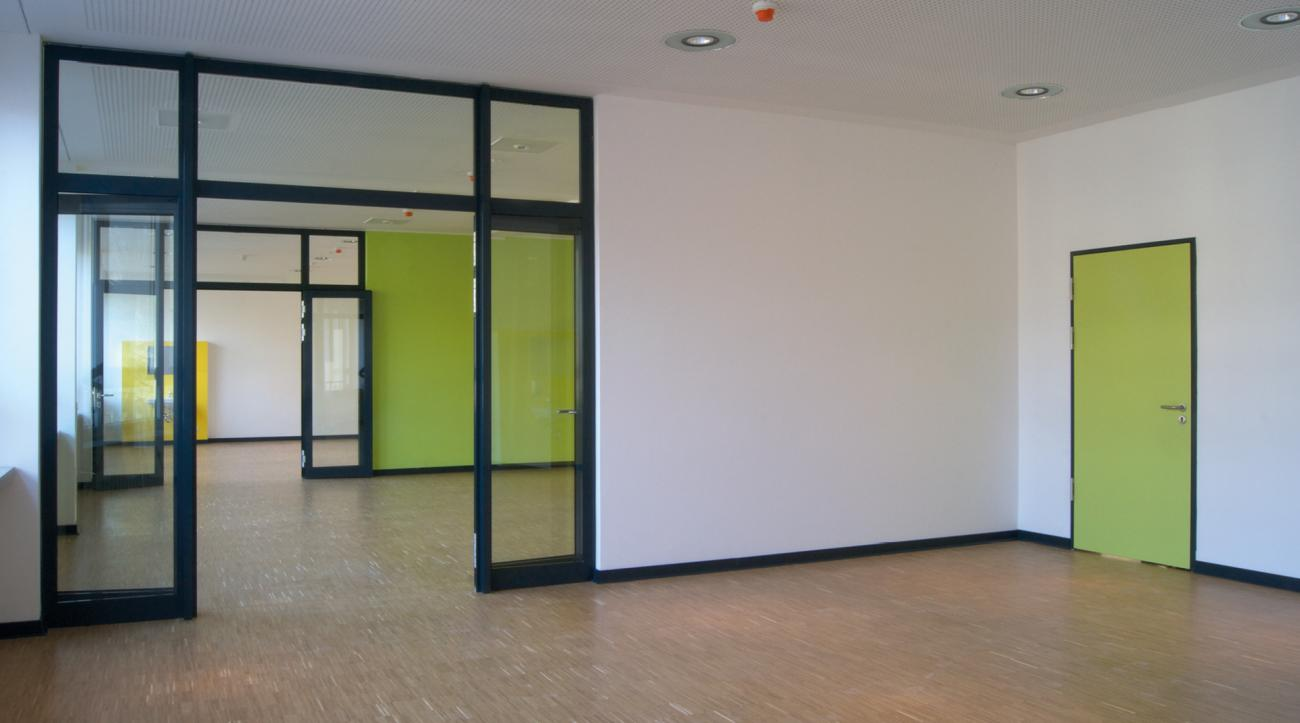 glass walls allow flexible use of the premises in the redesigned existing buildings.