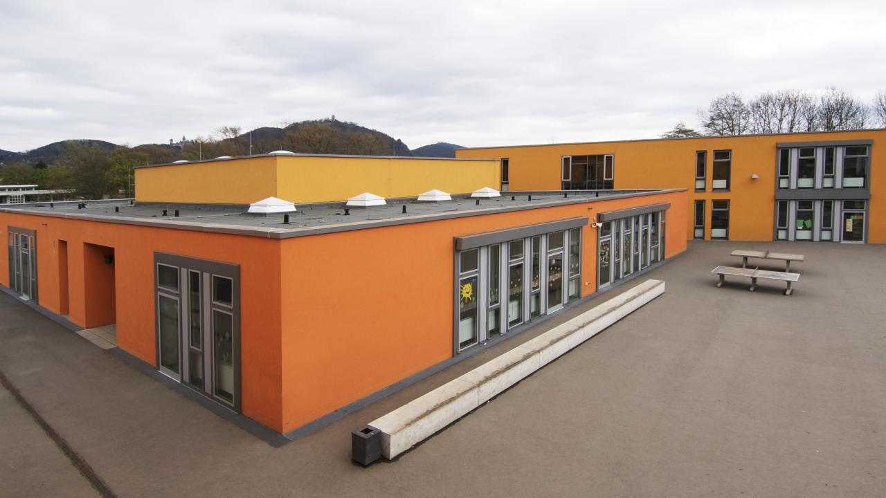 exterior view from the top of a building complex with single storey buildings and schoolyard