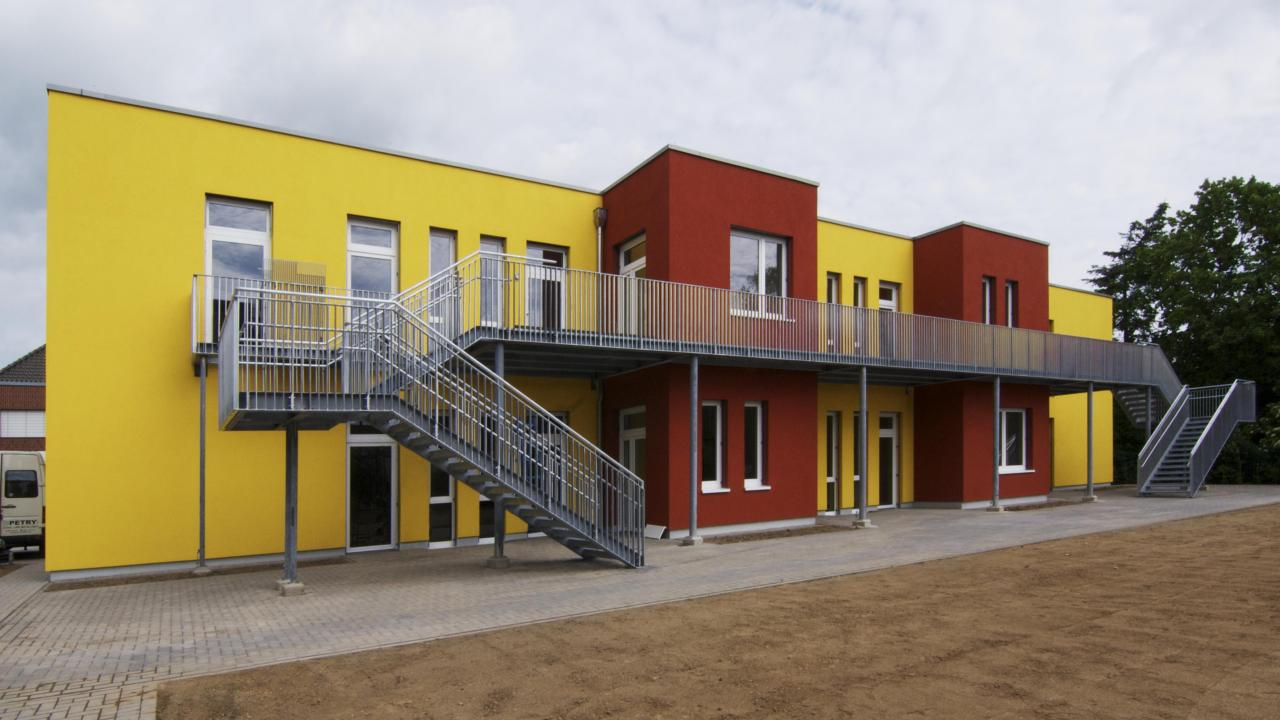 2-storey building with external stairs as direct access to the outdoor play area